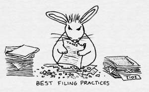 A rabbit surrounded by paperwork shreds tax documents.