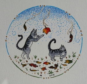 Two kittens leap and pounce on colorful falling leaves.