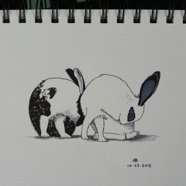 Two black and white bunnies groom themselves in symmetrical positions.