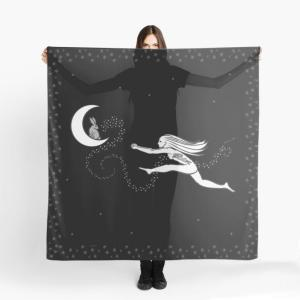 A woman stands holding a scarf with the image of a woman leaping, arms outstretched, towards a rabbit in the moon.