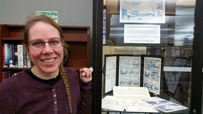 Akire with the Pika's Peak display case at Abington Free Library