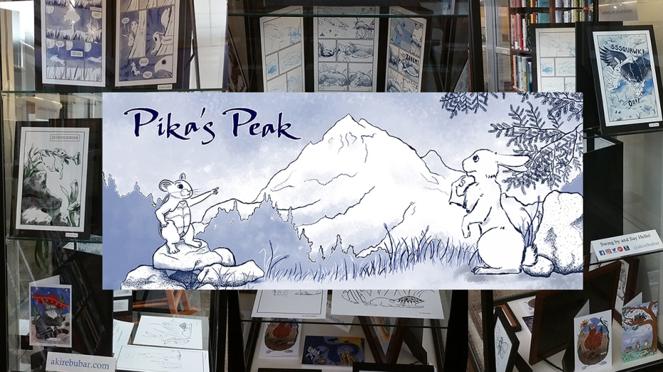 The banner for the comic Pika's Peak, showing a pika in a turtle shell pointing at a mountain to her friend a rabbit, is shown over images of the Pika's Peak display at the Abington Free Library.