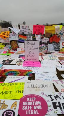 Countless protest signs are laid on the ground and tucked into the White House fence at #womensmarchdc. Photo by Kristina A. Boylan.