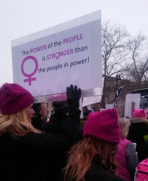 "Photo of #womensmarchphilly featuring a sign that reads ""The Power of the People is Stronger than the people in power!"" Photo by Edie Weinstein."